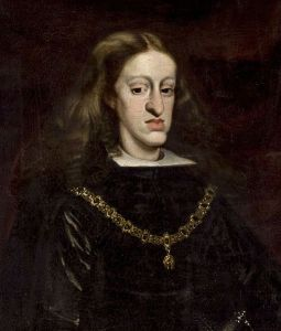 The guy with the overextended lower jaw is Carlos II of Spain, whose inability to father children and death began the War of the Spanish Succession